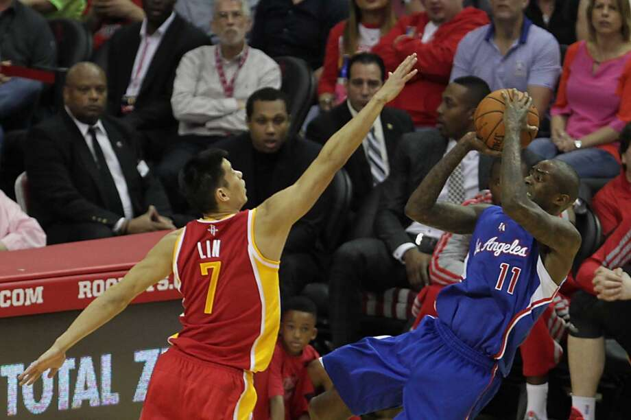 Los Angeles Clippers guard Jamal Crawford right, shoots the ball over Houston Rockets guard Jeremy Lin left, during the second half of NBA game action at the Toyota Center Saturday, March 29, 2014, in Houston. ( James Nielsen / Houston Chronicle ) Photo: James Nielsen, Houston Chronicle