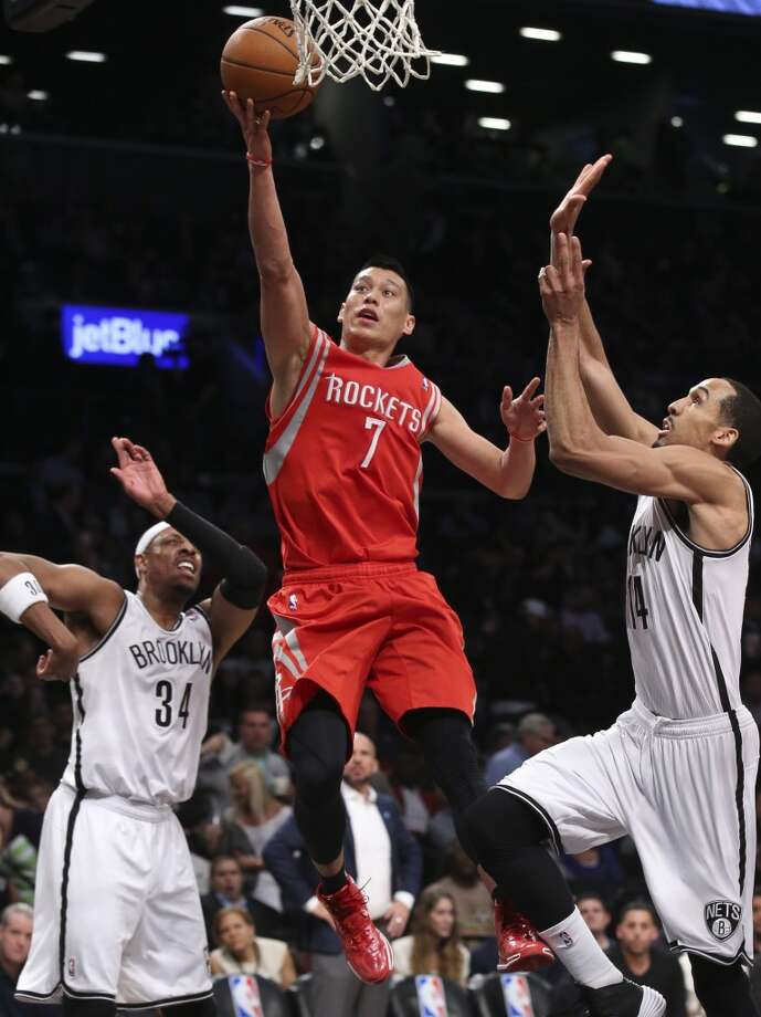 Houston Rockets guard Jeremy Lin (7) shoots against Brooklyn Nets guard Shaun Livingston (14) as forward Paul Pierce (34) looks on during the second half of their NBA basketball game at the Barclays Center, Tuesday, April 1, 2014, in New York. (AP Photo/John Minchillo) Photo: John Minchillo, Associated Press