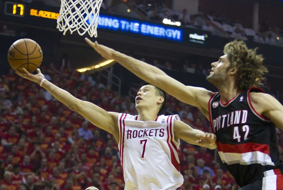 Houston Rockets guard Jeremy Lin (7) drives in for a layup against Portland Trail Blazers center Robin Lopez (42) during the first quarter of Game 5 of the NBA Western Conference quarterfinal basketball playoff game at Toyota Center Wednesday, April 30, 2014, in Houston. ( Brett Coomer / Houston Chronicle ) Photo: Brett Coomer, Houston Chronicle