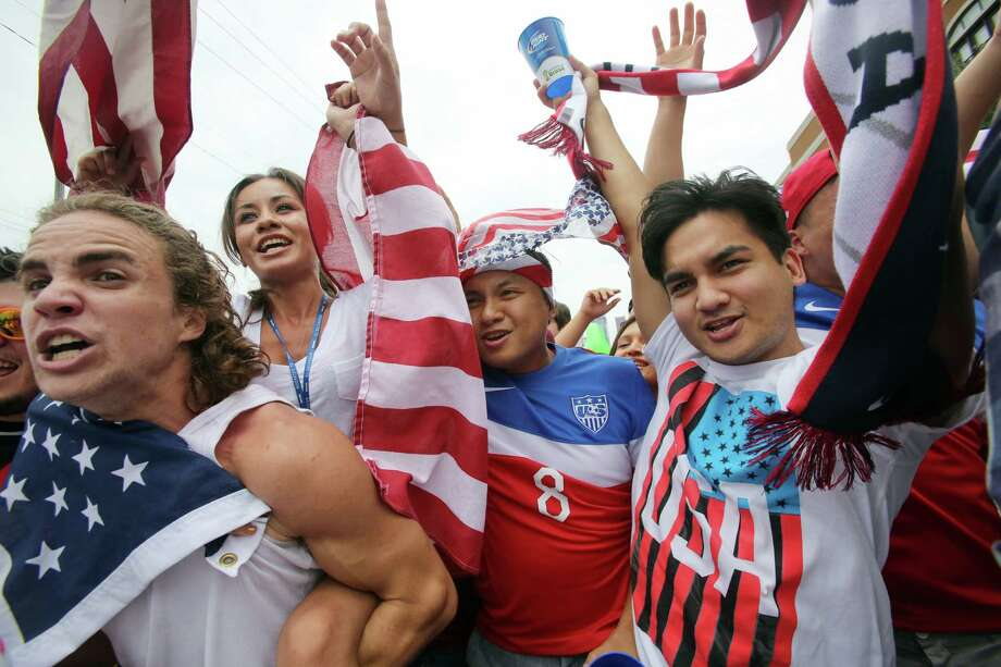 Germany beat USA 1-0, but U.S. soccer fans celebrate advancement to the knockout stage. Photo: Mayra Beltran, Staff / © 2014 Houston Chronicle