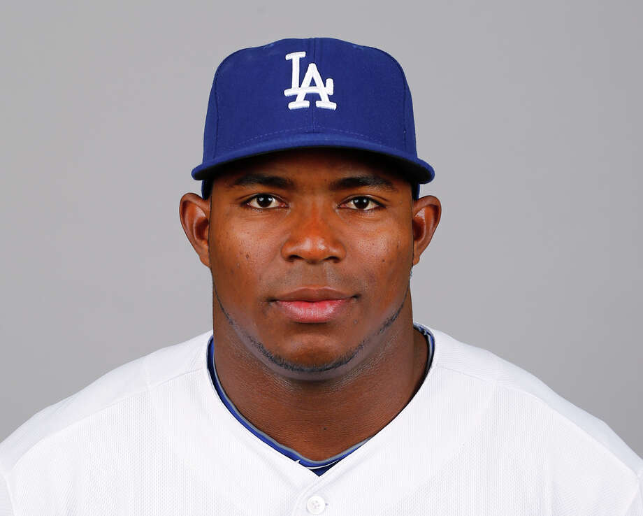 FILE - This is a 2014 file photo showing Yasiel Puig of the Los Angeles Dodgers baseball team. A Miami judge has denied a motion by Puig to dismiss a lawsuit filed by a Cuban man blaming the player for his imprisonment and torture on the communist island. (AP Photo/Paul Sancya, File) Photo: Paul Sancya, STF / MLBPV AP