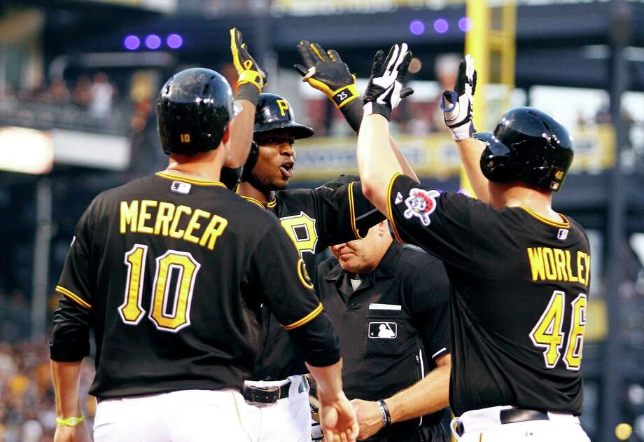 Rookie Gregory Polanco, center, celebrates his three-run homer with Vance Worley and Jordy Mercer in the Pirates' 5-2 victory over the Mets. Since coming to the majors on June 10, Polanco is hitting .338 in 16 games. Photo: Justin K. Aller, Stringer / 2014 Getty Images