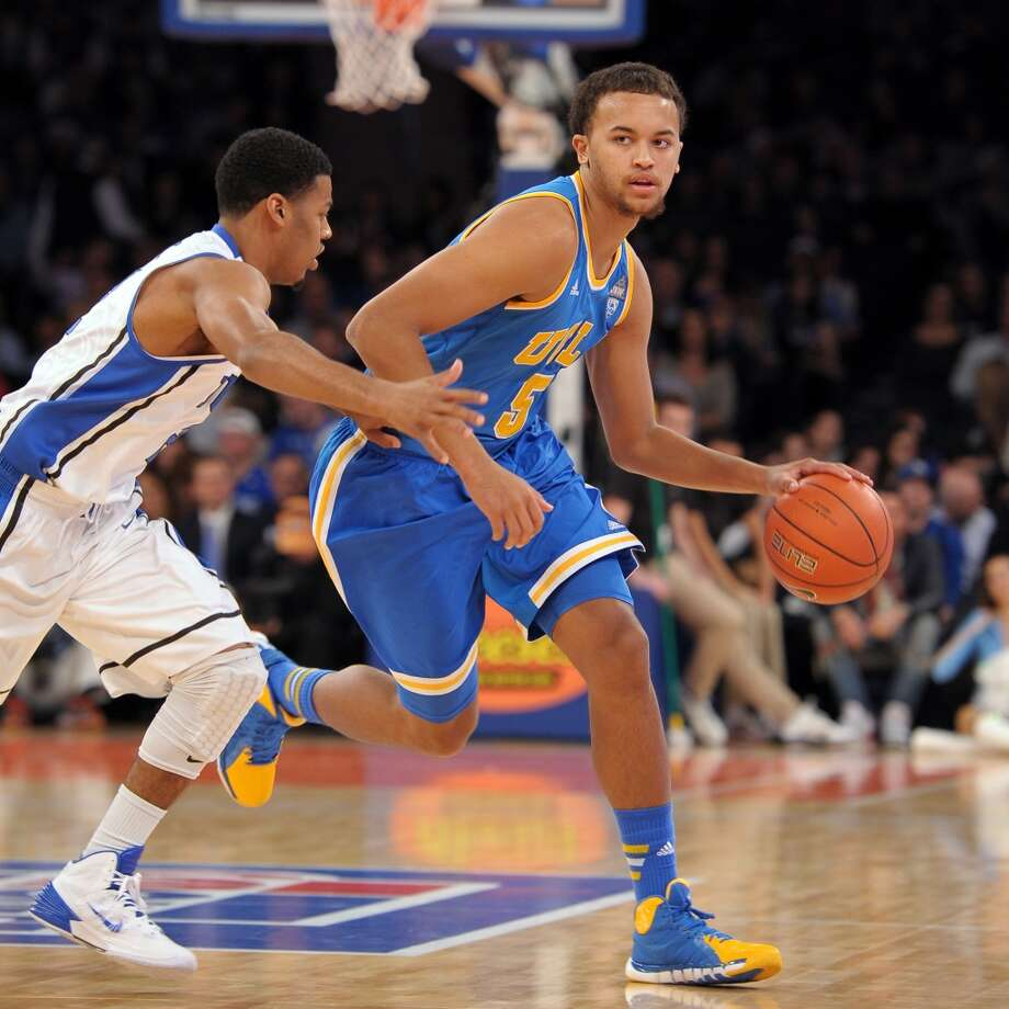 Kyle Anderson #5 of the UCLA Bruins dribbles against Quinn Cook #2 of the Duke Blue Devils during the CARQUEST Auto Parts Classic at Madison Square Garden on December 19, 2013 in New York City. Duke defeated UCLA 80-63. Photo: Lance King, Getty Images