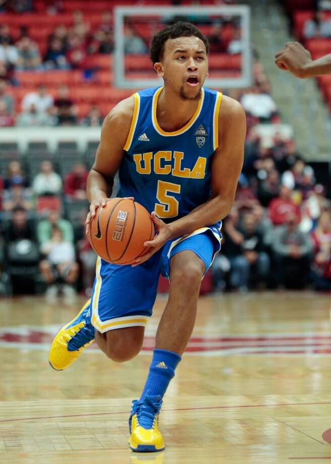 Kyle Anderson #5 of the UCLA Bruins controls the ball against the Washington State Cougars during the game at Beasley Coliseum on March 8, 2014 in Pullman, Washington. Photo: William Mancebo, Getty Images
