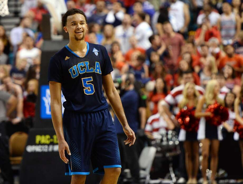 Kyle Anderson #5 of the UCLA Bruins smiles on the court late in the championship game of the Pac-12 Basketball Tournament against the Arizona Wildcats at the MGM Grand Garden Arena on March 15, 2014 in Las Vegas, Nevada. UCLA won 75-71. Photo: Ethan Miller, Getty Images