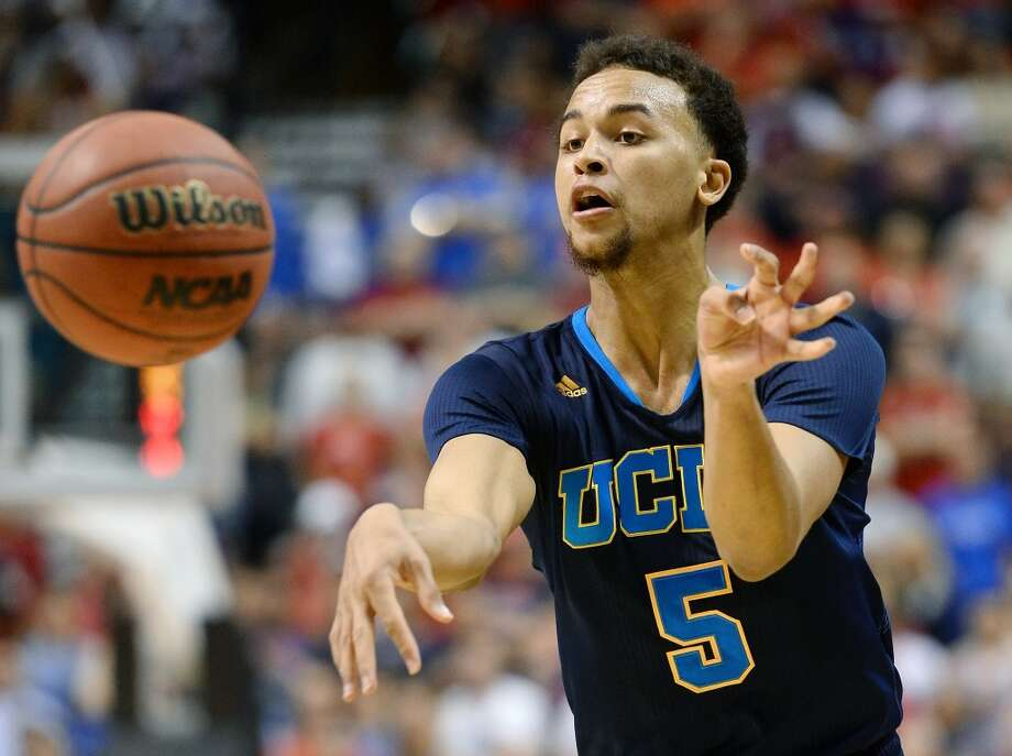 Kyle Anderson #5 of the UCLA Bruins passes against the Arizona Wildcats during the championship game of the Pac-12 Basketball Tournament at the MGM Grand Garden Arena on March 15, 2014 in Las Vegas, Nevada. UCLA won 75-71. Photo: Ethan Miller, Getty Images