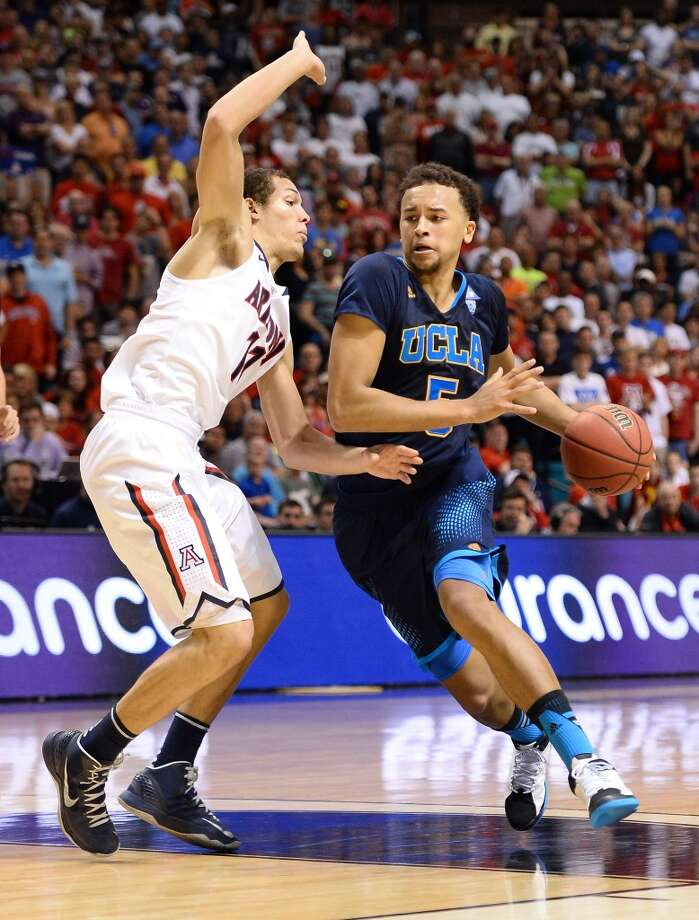Kyle Anderson #5 of the UCLA Bruins drives against Aaron Gordon #11 of the Arizona Wildcats during the championship game of the Pac-12 Basketball Tournament at the MGM Grand Garden Arena on March 15, 2014 in Las Vegas, Nevada. UCLA won 75-71. Photo: Ethan Miller, Getty Images