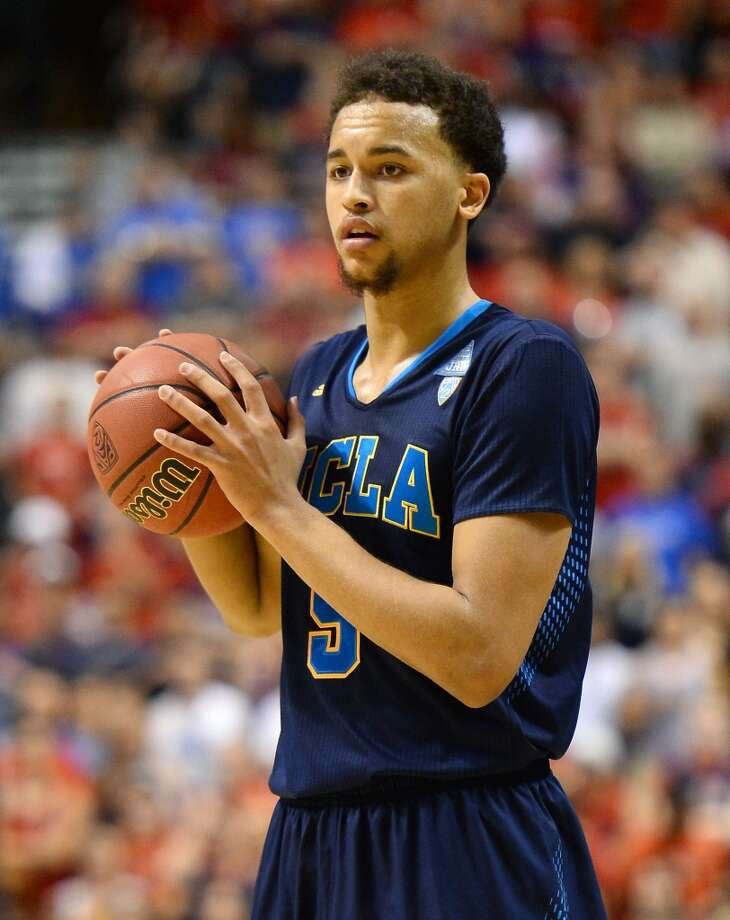 Kyle Anderson #5 of the UCLA Bruins looks to pass against the Arizona Wildcats during the championship game of the Pac-12 Basketball Tournament at the MGM Grand Garden Arena on March 15, 2014 in Las Vegas, Nevada. UCLA won 75-71. Photo: Ethan Miller, Getty Images
