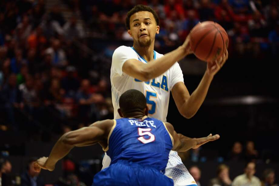 Kyle Anderson #5 of the UCLA Bruins looks to pass against Tim Peete #5 of the Tulsa Golden Hurricane during the second round of the 2014 NCAA Men's Basketball Tournament at Viejas Arena on March 21, 2014 in San Diego, California. Photo: Donald Miralle, Getty Images