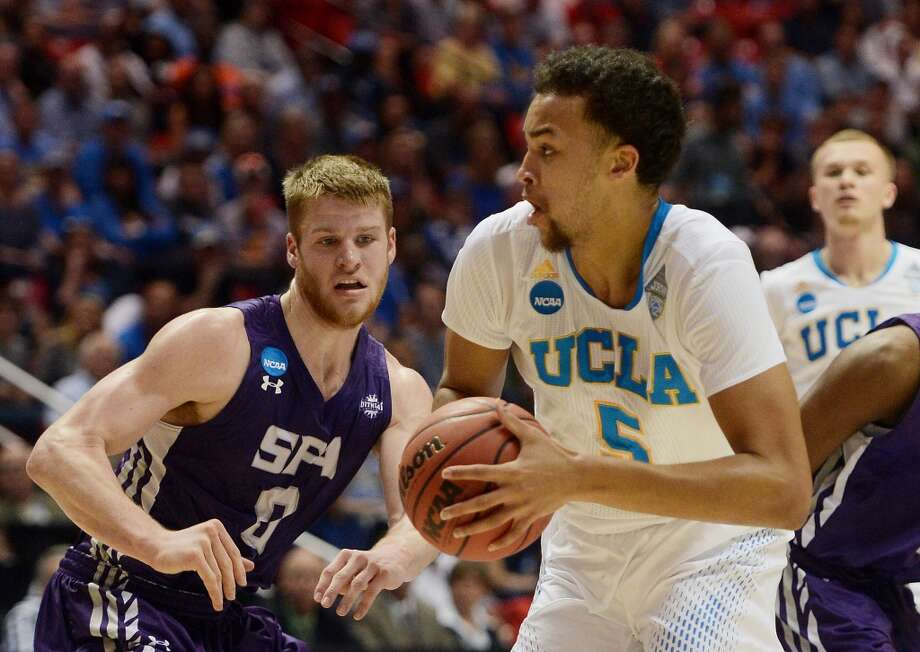 Kyle Anderson #5 of the UCLA Bruins drives against Thomas Walkup #0 of the Stephen F. Austin Lumberjacks in the first half during the third round of the 2014 NCAA Men's Basketball Tournament at Viejas Arena on March 23, 2014 in San Diego, California. Photo: Donald Miralle, Getty Images