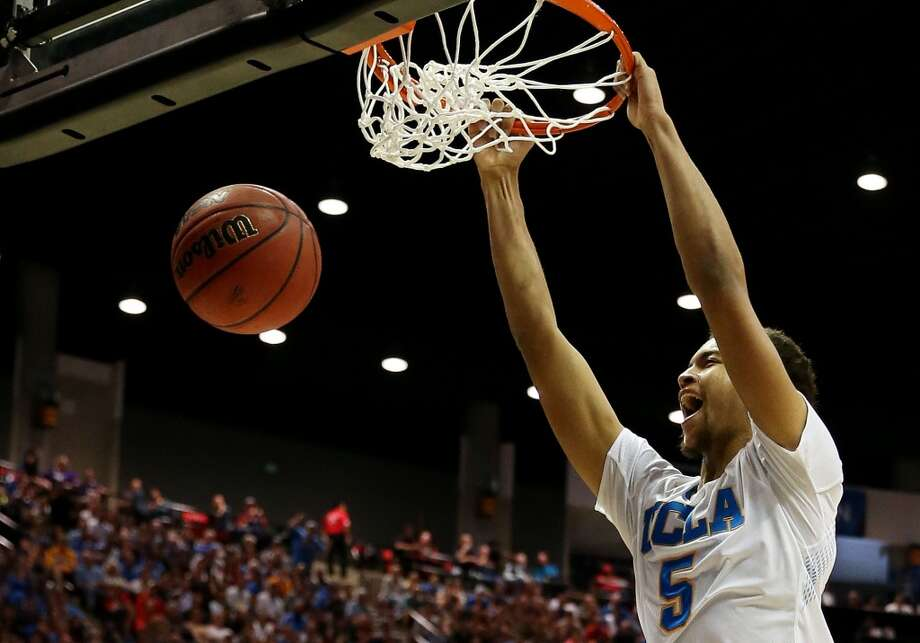 Kyle Anderson #5 of the UCLA Bruins dunks against the Stephen F. Austin Lumberjacks in the second half during the third round of the 2014 NCAA Men's Basketball Tournament at Viejas Arena on March 23, 2014 in San Diego, California. Photo: Jeff Gross, Getty Images