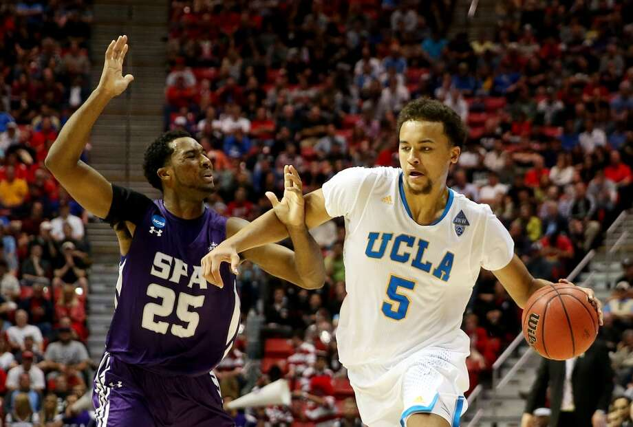 Kyle Anderson #5 of the UCLA Bruins drives against Desmond Haymon #25 of the Stephen F. Austin Lumberjacks in the second half during the third round of the 2014 NCAA Men's Basketball Tournament at Viejas Arena on March 23, 2014 in San Diego, California. Photo: Jeff Gross, Getty Images