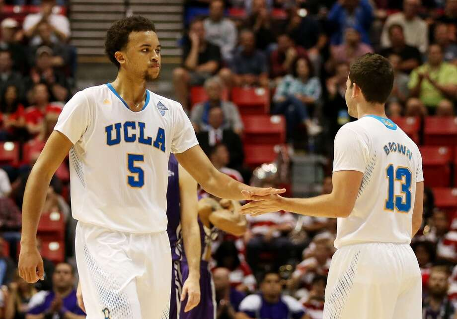 Kyle Anderson #5 and David Brown #13 of the UCLA Bruins celebrate their 77 to 60 win over the Stephen F. Austin Lumberjacks during the third round of the 2014 NCAA Men's Basketball Tournament at Viejas Arena on March 23, 2014 in San Diego, California. Photo: Jeff Gross, Getty Images