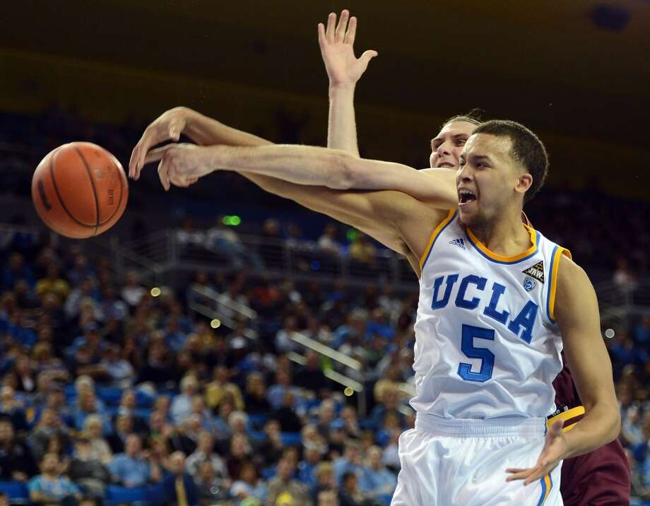 Kyle Anderson #5 of the UCLA Bruins and Jordan Bachynski #13 of the Arizona State Sun Devils reach for a rebound at Pauley Pavilion on February 27, 2013 in Los Angeles, California. Photo: Harry How, Getty Images