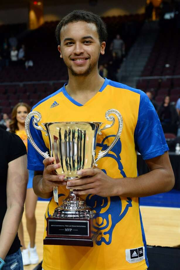 Kyle Anderson #5 of the UCLA Bruins holds the tournament's MVP trophy after the Bruins defeated the Northwestern Wildcats 95-79 during the Continental Tire Las Vegas Invitational at the Orleans Arena on November 29, 2013 in Las Vegas, Nevada. UCLA won 95-79. Photo: Ethan Miller, Getty Images