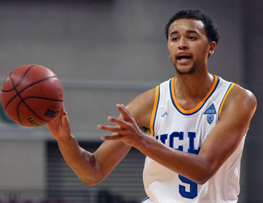 Kyle Anderson #5 of the UCLA Bruins looks to pass against the Northwestern Wildcats during the Continental Tire Las Vegas Invitational at the Orleans Arena on November 29, 2013 in Las Vegas, Nevada. UCLA won 95-79. Photo: Ethan Miller, Getty Images