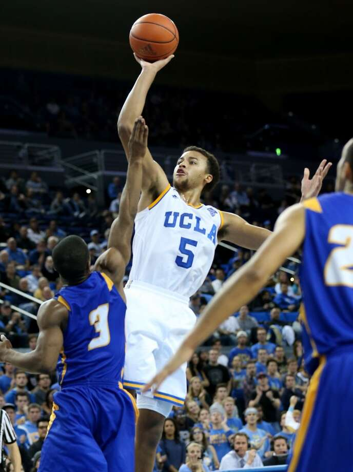 Kyle Anderson #5 of the UCLA Bruins shoots over Zalmico Harmon #5 of the UCSB Gauchos at Pauley Pavilion on December 3, 2013 in Los Angeles, California.  UCLA won 89-76. Photo: Stephen Dunn, Getty Images