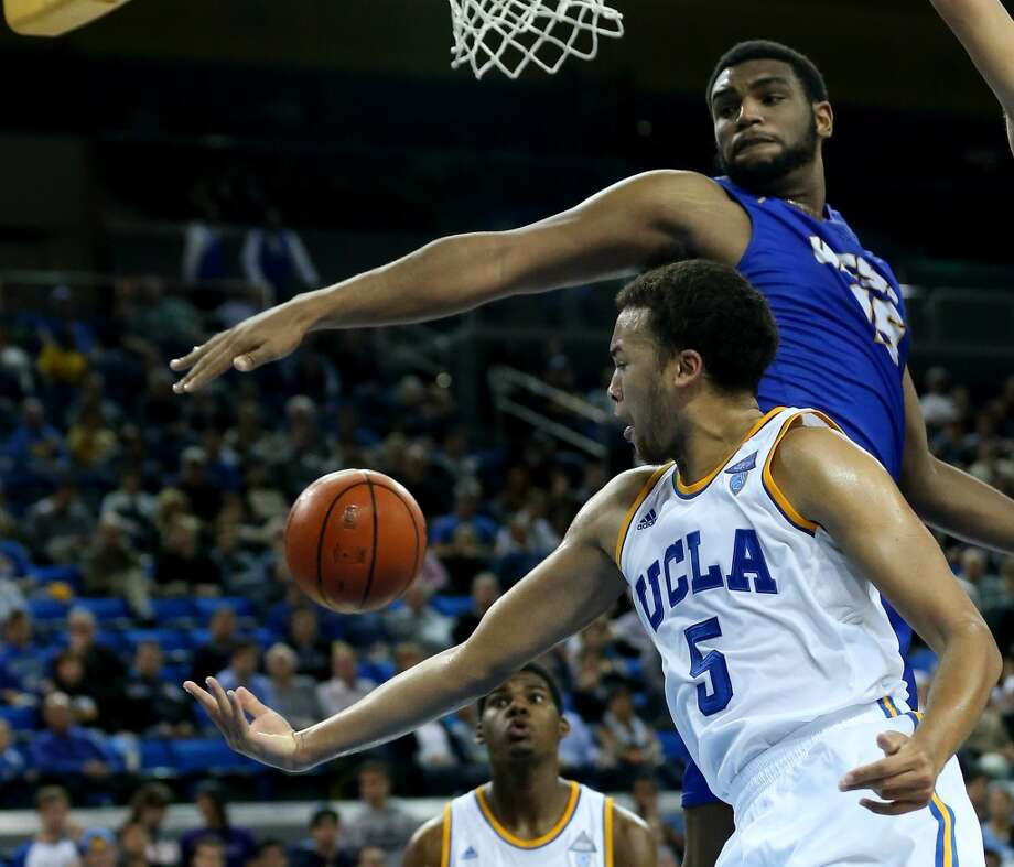 Kyle Anderson #5 of the UCLA Bruins and Alan Williams #15 of the UCSB Gauchos go for the ball at Pauley Pavilion on December 3, 2013 in Los Angeles, California.  UCLA won 89-76. Photo: Stephen Dunn, Getty Images