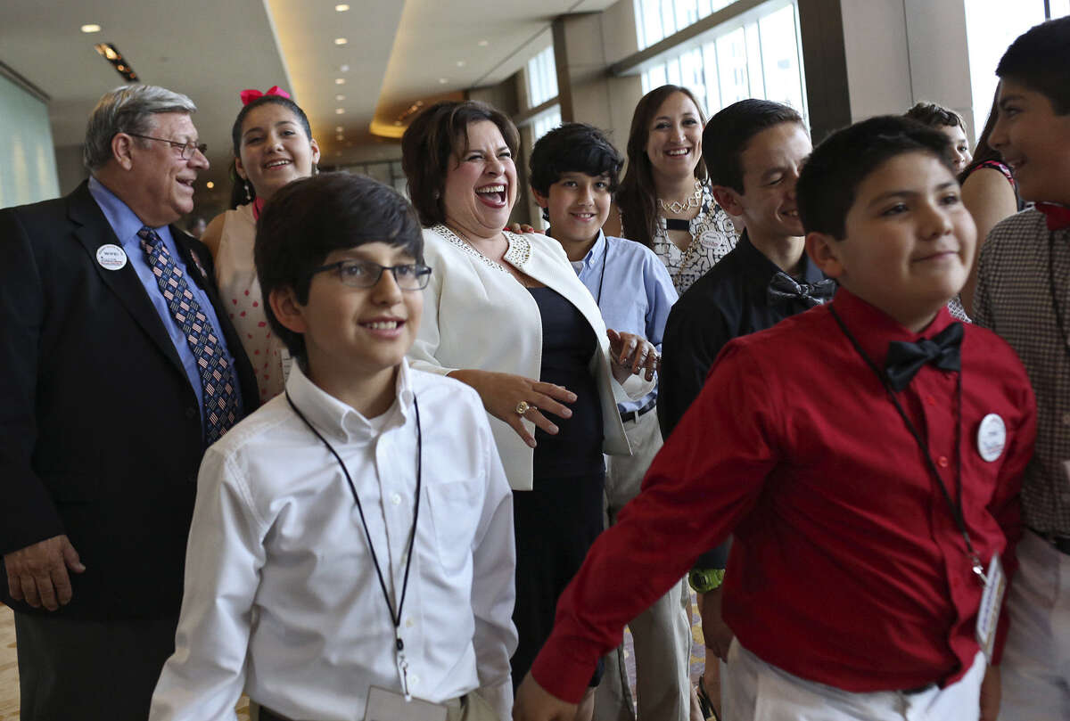 Lt. Gov. candidate State Sen. Leticia Van de Putte, the Democratic selection for lieutenant governor, laughs with family after they took a selfie between Texas Democratic Convention events in Dallas.