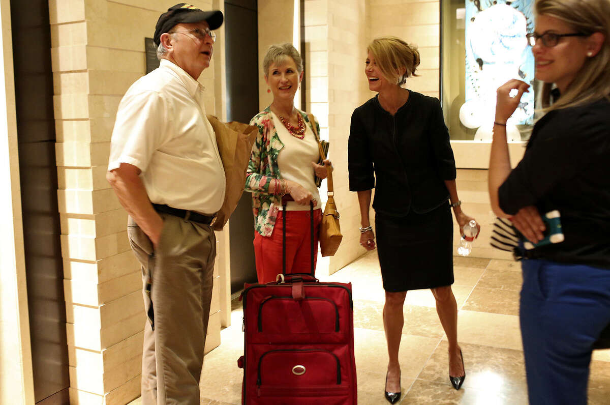 Wendy Davis, the Democratic candidate for governor, visits with prospective voters as they wait for the elevator in Dallas before the Texas Democratic Convention.
