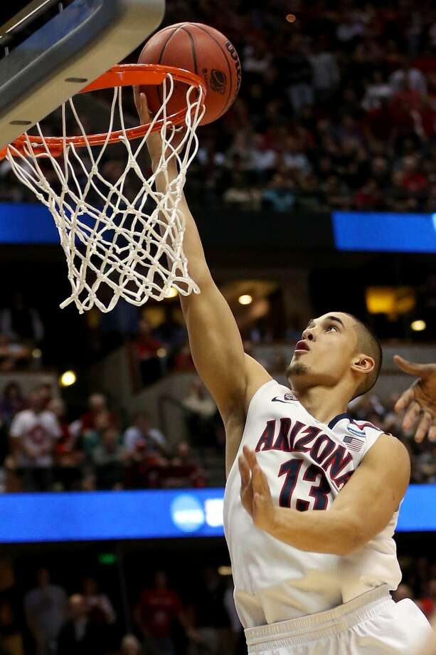 ANAHEIM, CA - MARCH 27:  Nick Johnson #13 of the Arizona Wildcats makes a basket in the second half against the San Diego State Aztecs during the regional semifinal of the 2014 NCAA Men's Basketball Tournament at the Honda Center on March 27, 2014 in Anaheim, California.  (Photo by Jeff Gross/Getty Images) Photo: Jeff Gross, Getty Images