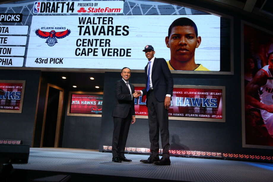 BROOKLYN, NY - JUNE 26: Walter Tavares shakes hands with NBA Deputy Commissioner Mark Tatum after being selected number forty third overall by the Atlanta Hawks during the 2014 NBA Draft on June 26, 2014 at Barclays Center in Brooklyn, New York. NOTE TO USER: User expressly acknowledges and agrees that, by downloading and or using this photograph, User is consenting to the terms and conditions of the Getty Images License Agreement. Mandatory Copyright Notice: Copyright 2014 NBAE (Photo by Nathaniel S. Butler /NBAE via Getty Images) Photo: Nathaniel S. Butler, NBAE/Getty Images / 2014 NBAE