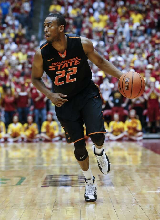 AMES, IA - MARCH 8: Markel Brown #22 of the Oklahoma State Cowboys drives the ball down court in the second half of play against Iowa State at Hilton Coliseum on March 8, 2014 in Ames, Iowa. Iowa State defeated Oklahoma State 85-81 in overtime. (Photo by David K Purdy/Getty Images) Photo: David K Purdy, Getty Images