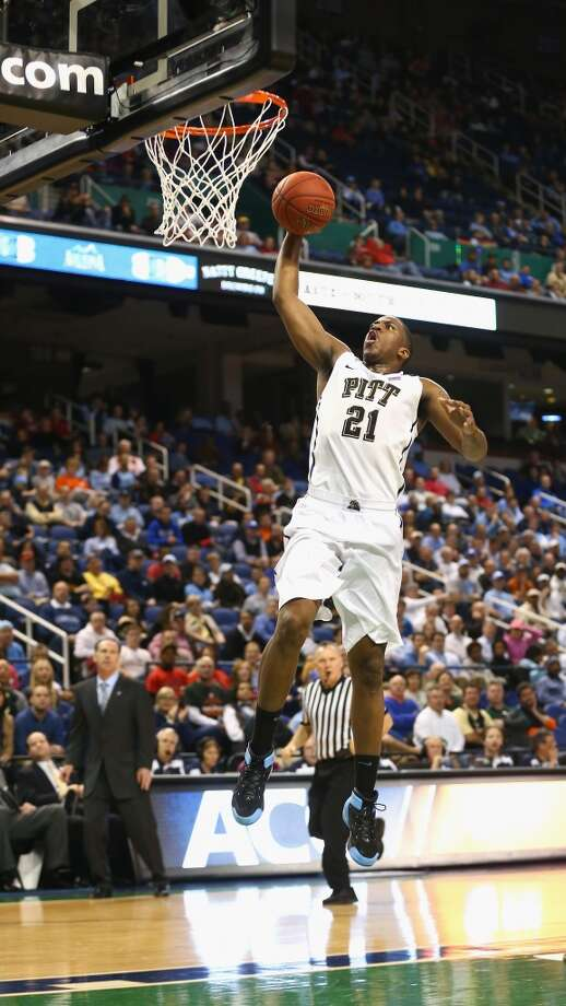 GREENSBORO, NC - MARCH 13: Lamar Patterson #21 of the Pittsburgh Panthers goes for the dunk against the Wake Forest Demon Deacons during the second round of the 2014 Men's ACC Basketball Tournament at Greensboro Coliseum on March 13, 2014 in Greensboro, North Carolina.  (Photo by Streeter Lecka/Getty Images) Photo: Streeter Lecka, Getty Images