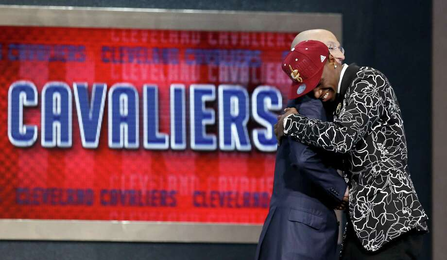 Top pick Andrew Wiggins shares a hug with NBA commissioner Adam Silver after being selected by the Cleveland Cavaliers. Photo: Kathy Willens / Associated Press / AP