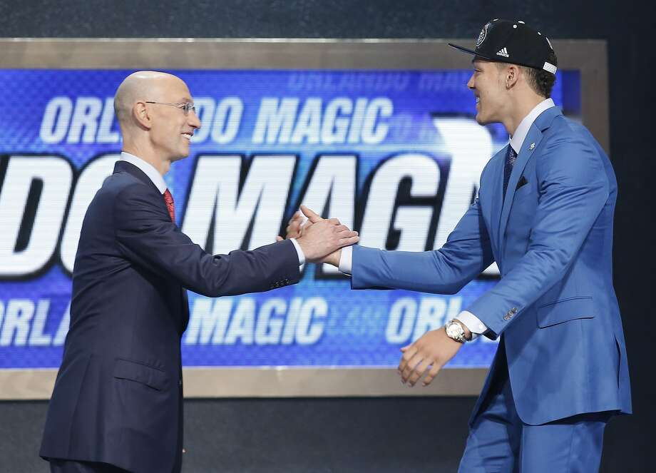 Ex-Mitty star Aaron Gordon is greeted by Commissioner Adam Silver after being picked by the Magic. Photo: Kathy Willens, Associated Press
