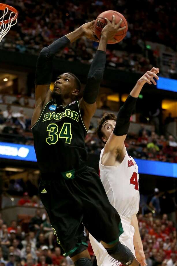 Cory Jefferson #34 of the Baylor Bears goes up for a dunk against Frank Kaminsky #44 of the Wisconsin Badgers in the second half during the regional semifinal of the 2014 NCAA Men's Basketball Tournament at the Honda Center on March 27, 2014 in Anaheim, California. Photo: Jeff Gross, Getty Images
