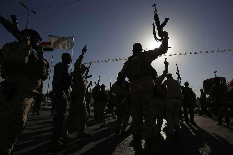 TOPSHOTS Members of the Al-Abbas brigades, who volunteered to protect the Shiite Muslim holy sites