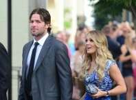 Semiformal or dressy casual:   Carrie Underwood and husband Nashville Predator hockey player Mike Fisher are picture perfect for the wedding of Kimberly Perry, from the Band Perry, to Texas Rangers baseball player J.P. Arencibi in Greeneville, Tenn.