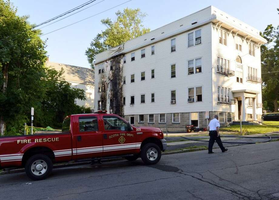 An apartment building that is near the Scotia Fire Department was damaged by fire late Thursday. The building at 11 N. Ten Broeck St., sustained visible damage in the blaze. (Skip Dickstein / Times Union)