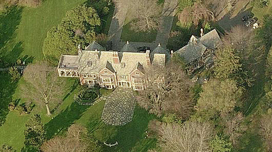 The 20-acre estate on Sasco Point owned by Bradley and Karin Jack tops the list of tax-delinquent properties in town -- $294,900 -- as of June 5, according to Tax Collector records. Photo: File Photo / Fairfield Citizen