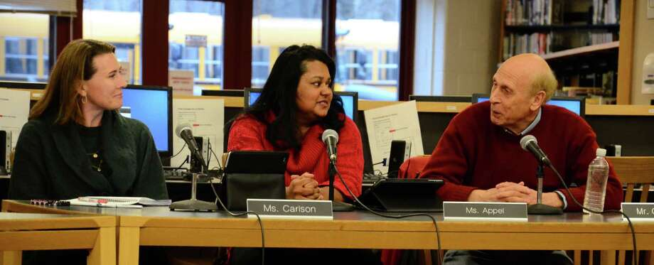 Board of Education members Dionna Carlson, Sangeeta Appel and Gene Goodman at a special meeting March 17, 2014, at the New Canaan High School library. Photo: Nelson Oliveira / New Canaan News