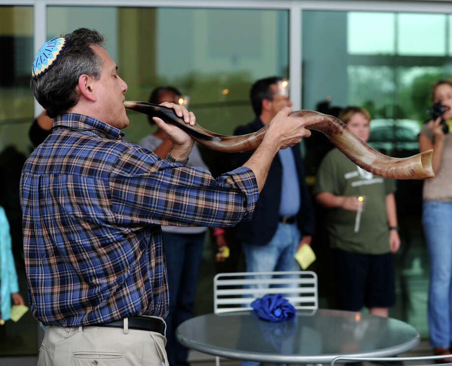 "Rabbi Joshua Taub sounds a shofar at the end of Thursday's prayer service at the Event Centre. A crowd gathered at the Event Centre on Thursday evening to participate in ""Pray for One Another,"" a communal prayer service for the teachers, staff, and students of the Beaumont Independent School District. Photo taken Thursday 6/26/14 Jake Daniels/@JakeD_in_SETX Photo: Jake Daniels / ©2014 The Beaumont Enterprise/Jake Daniels"