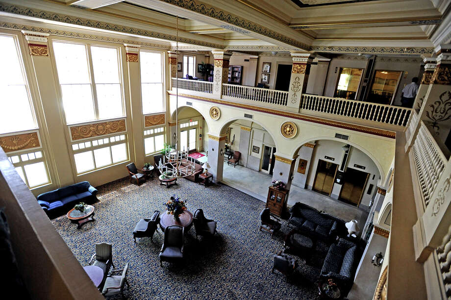 By the looks of the lobby and mezzanine of Hotel Beaumont you would think business hadn't stopped.  Besides a bit of dust the hotel is still fully furnished on the first two floors. Photo taken Friday, August 2, 2013. Photo taken: Randy Edwards/The Enterprise
