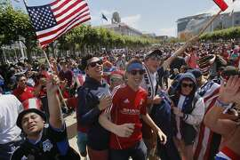 Spectators cheer at Civic Center Plaza at the end of the US-Germany World Cup match on June 26, 2014. San Francisco Recreation and Parks hosted a live viewing party of the US-Germany World Cup match at the plaza.