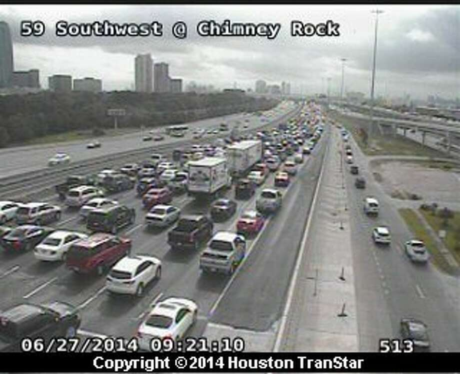 Traffic was snarled Friday morning on U.S. 59 in southwest Houston after a crash during rush hour. Photo: Houston TranStar