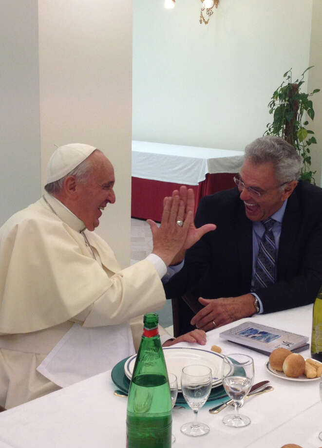 Evangelist James Robsion, founder of Life Outreach International based in Euless, Texas, shares a high-five with Pope Francis at the Vatican on June 24, 2014.Click through the slideshow for more cool things Pope Francis has done.  Photo: Photo Courtesy Life Outreach International