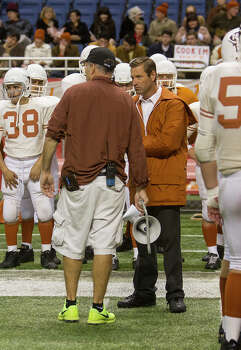 Aaron Eckhart getting direction from assistant director J.B. Rogers, on the set of the film, My All American at the Alamodome, Thursday, June 26, 2014. Eckhart plays University of Texas Longhorns head coach Darrell K. Royal in the film. Photo: Alma E. Hernandez, Alma E. Hernandez / For The San