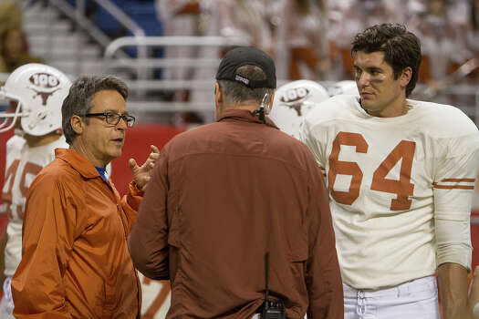 (Left to right) Angelo Pizzo, director of My All American, J.B. Rogers, assistant director and Rett Terrell at the Alamodome, Thursday, June 26, 2014. Terrell plays Bobby Mitchell, best friend to Freddie Steinmark, a former Longhorn football player who the film is based on. Photo: Alma E. Hernandez, Alma E. Hernandez / For The San
