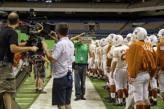 Filming a scene from My All American at the Alamodome, Thursday, June 26, 2014 about former University of Texas football player Freddie Steinmark. Photo: Alma E. Hernandez, Alma E. Hernandez / For The San