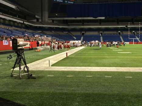 Film crews descended on the Alamodome Thursday to film a portion of a movie about a University of Texas defensive back. Photo: Kolten Parker/San Antonio Express-News
