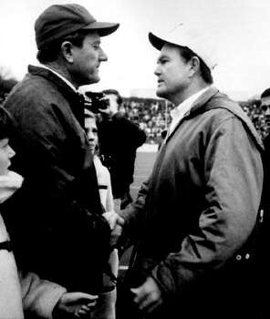 ** FILE ** Arkansas football coach Frank Broyles, left, and Texas coach Darrell Royal greet on the field in Fayetteville, Ark., in this Dec. 6, 1969, photo. No. 1 Texas defeated no. 2 Arkansas 15-14. In its heyday, no rivalry was better than Texas vs. Arkansas.      It was a regular showdown on the third Saturday in October, one week after Texas played Oklahoma. Photo: AP / ARKANSAS DEMOCRAT GAZETTE