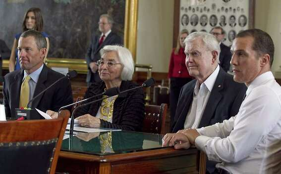 Edith Royal, wife of former Texas NCAA college football coach Darrell Royal, second from right, announces that the family foundation named after her husband, DKR Fund for Alzheimer's Research, would fund Alzheimer's disease research in Texas during a joint legislative hearing held at the State Capitol in Austin, Texas, on Tuesday, Feb. 28, 2012.  Supporters of the foundation seven-time Tour de France winner Lance Armstrong, left, and actor Matthew McConaughey, right,  also attended the hearing. (Austin American-Statesman, Rodolfo Gonzalez) MAGS OUT; NO SALES; INTERNET AND TV MUST CREDIT PHOTOGRAPHER AND STATESMAN.COM Photo: AP