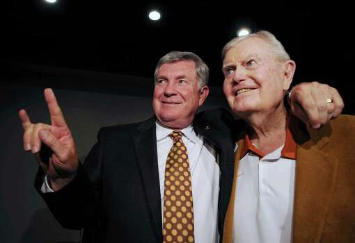 """Texas football coach Mack Brown, left, gives the """"hook 'em horns"""" sign next to former coach Darrell Royal, right, at a reception before the induction for the 2012 class of the Texas Sports Hall of Fame, Wednesday, Feb. 29, 2012 in Waco, Texas. (AP Photo/Waco Tribune Herald, Rod Aydelotte)     at a reception before the induction for the 2012 class of the Texas Sports Hall of Fame, Tuesday, Feb. 29, 2012 in Waco, Texas. (AP Photo/Waco Tribune Herald, Photo: Rod Aydelotte, Associated Press / Waco Tribune Herald"""