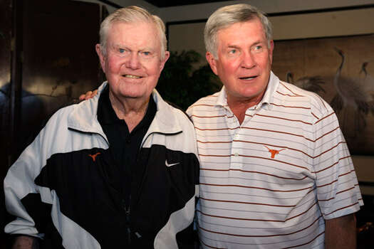 Texas football coach Mack Brown (right) and former coach Darrell Royal talk with the media before Brown spoke to the San Antonio Quarterback Club on Monday.