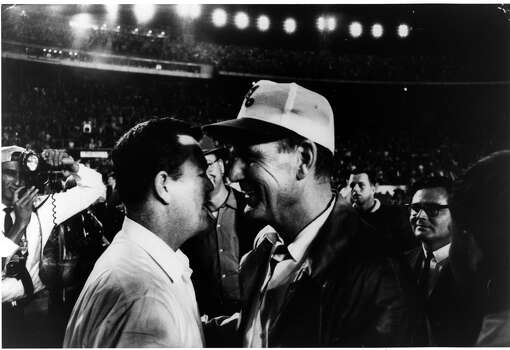 UT coach Darrell Royal (left) and Alabama's Bear Bryant meet after the Longhorns won the 1965 Orange Bowl, 21-17.
